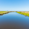 Scenic Titiroa Stream in Southland leading to coast with  traditional whitebaiter shacks