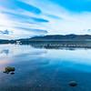 Float plane and yacht on calm lake Te Anau before sunrise