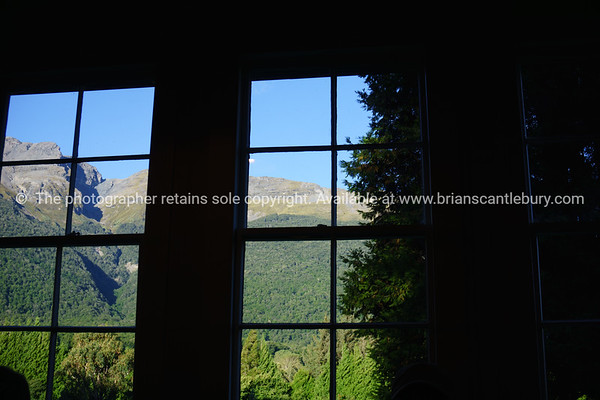 South Island Scenic. Southern Alps through windows of old school room at Paradise, the interior silhouetted against the outdoor environment.