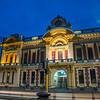 Night on city street with City Hall illuminated