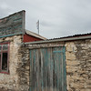Old stone and wooden builders building, Clyde, NZ.