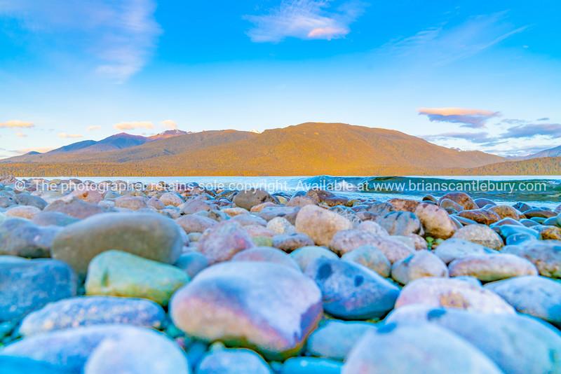 View across Lake Te Anau to Murchison Mountains just before sunrise