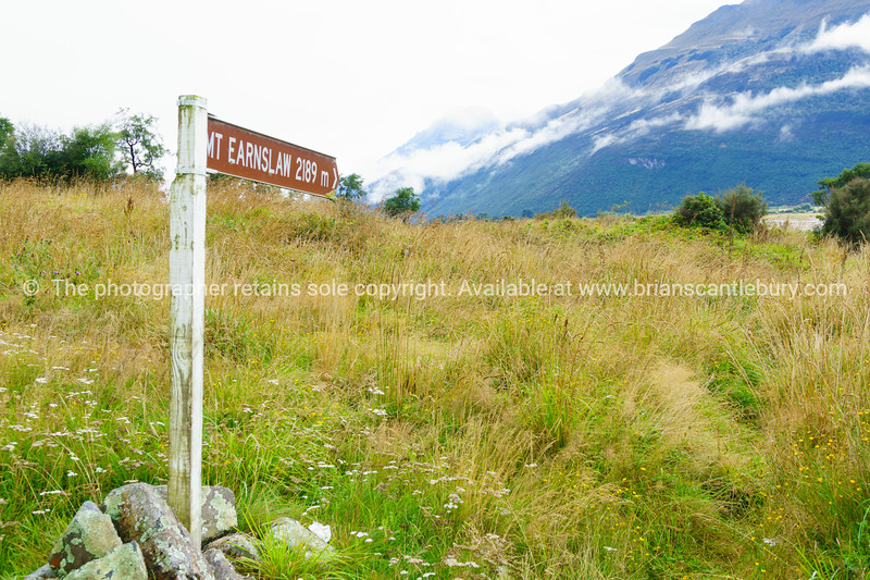 Tourism signpost point to Mt Earnslaw in Central Otago