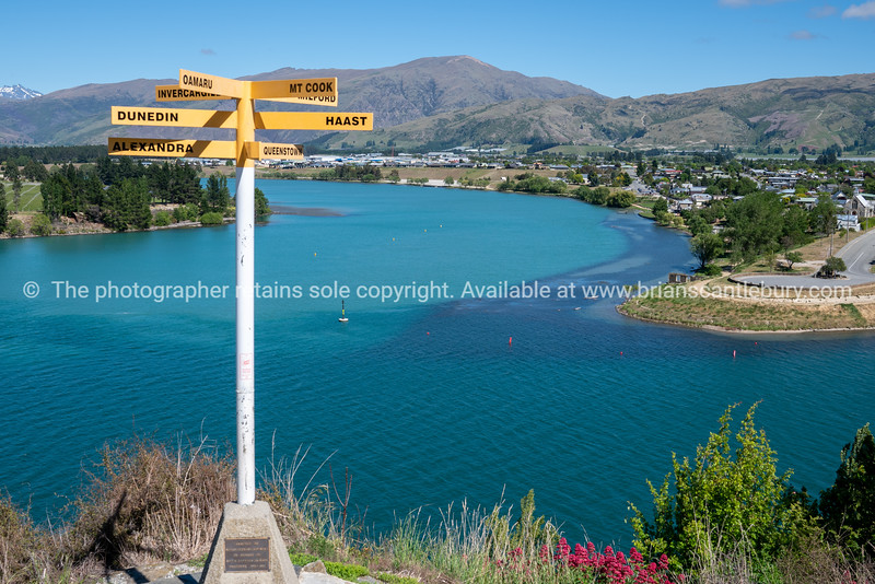Central Otago town of Cromwell on bend in turquoise  Clutha and Kawarau Rivers in Central Otago New Zealand.