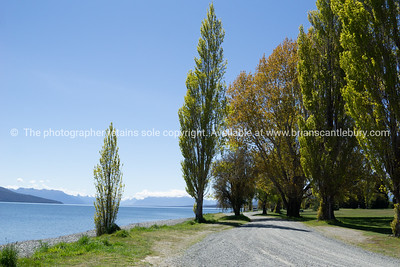 Dusty road around water's edge of Lake Te Anau
