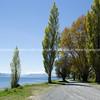 Dusty road around water's edge of Lake Te Anau
