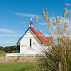 Old traditional design St Mary's Anglican Church in Waikawa with red roof and white exterior.