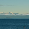 Snowclad mountains across Lake Taupo.