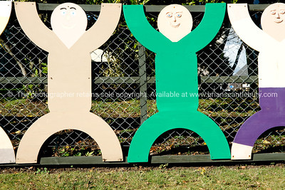 Children fixed to fence.