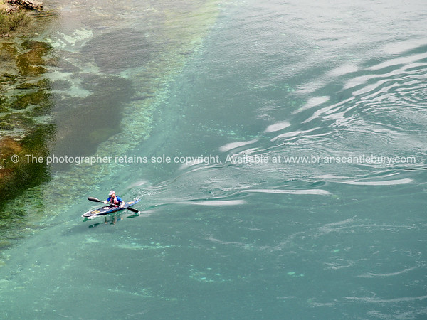 Lonely kayaker on Waikato River.