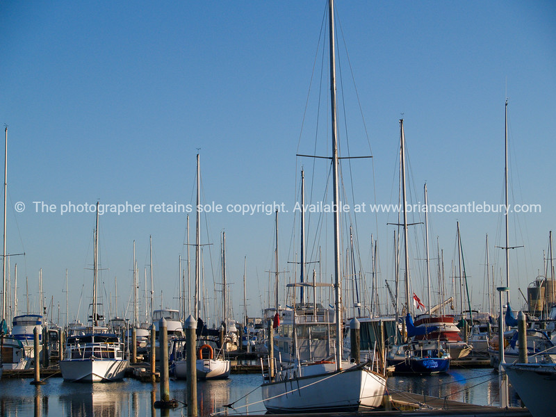 """Tauranga scenics.<br /> <br /> Marina, array of boats and masts. Tauranga Bridge Marina, New Zealand,. Tauranga is New Zealands 5th largest city and offers a wonderfull variety of scenic and cultural experiences. Tauranga stock images Tauranga scenics. See;  <a href=""""http://www.blurb.com/b/3811392-tauranga"""">http://www.blurb.com/b/3811392-tauranga</a> mount maunganui landscape photography, Tauranga Photos; Tauranga photos, Photos of Tauranga Also see; <a href=""""http://www.brianscantlebury.com/Events"""">http://www.brianscantlebury.com/Events</a>"""