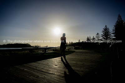 Silhouette on boardwalk, Mount maunganui