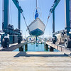 Tauranga Marina hardstand travel lift with yacht hoisted for maintenance