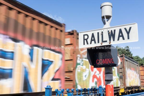 Railway sign and passing cargo train Tauranga, Mount Maunganui photos