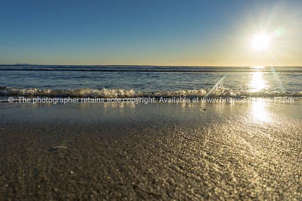 Papamoa Beach, outlok to horizon beautiful glow into  sunrise