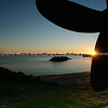 "Sunrises over the Tauranga Harbour. Scene from Sulphur Point framed by the old tug boat Taioma's propeller. Tauranga is New Zealands 5th largest city and offers a wonderfull variety of scenic and cultural experiences. Tauranga stock images Tauranga scenics. See;  <a href=""http://www.blurb.com/b/3811392-tauranga"">http://www.blurb.com/b/3811392-tauranga</a> mount maunganui landscape photography, Tauranga Photos; Tauranga photos, Photos of Tauranga Also see; <a href=""http://www.brianscantlebury.com/Events"">http://www.brianscantlebury.com/Events</a>"