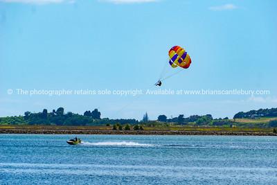 Jet ski towed paragliding obver bay.