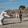 """Capoeira being practised on Mount Maunganui beach, Tauranga, New Zealand.<br /> Capoeira is a game, a sport, an art and a life philosophy, founded in Brasil in 1984. - 6<br /> Model Release; no. See;  <a href=""""http://www.blurb.com/b/3811392-tauranga"""">http://www.blurb.com/b/3811392-tauranga</a> mount maunganui landscape photography, Tauranga Photos; Tauranga photos, Photos of Tauranga Also see; <a href=""""http://www.brianscantlebury.com/Events"""">http://www.brianscantlebury.com/Events</a>"""