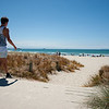 youth walks to beach on hot summer day, carrying his towel on January 22, 2015  at Mount Maunganui Mount, New Zealand. the beaches are key summer destinations.