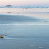 Defocused blurry background image oceanbeach long view in soft tones
