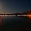 Night lights on railway bridge built in 1928, crosses the Tauranga Harbour joining downtown Tauranga to the Matapihi peninsula.
