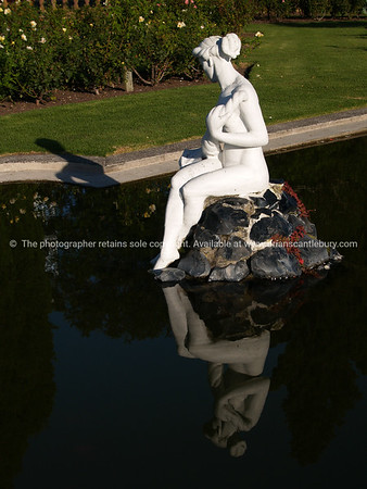 Tauranga scenics.  Lady in a pond, white lady statue on rock, Tauranga Rose gardens,New Zealand. Tauranga is New Zealands 5th largest city and offers a wonderfull variety of scenic and cultural experiences. Tauranga stock images Tauranga scenics. See; www.blurb.com/b/3811392-tauranga mount maunganui landscape photography, Tauranga Photos; Tauranga photos, Photos of Tauranga Also see; http://www.brianscantlebury.com/Events