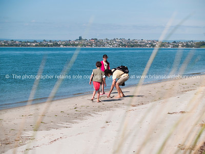 Family fun on Matakana Island, Tauranga, New Zealand.