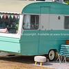 Retro style green and white caravan