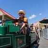 Model railway enthusiast engineers prepare vintage miniature train giving rides.