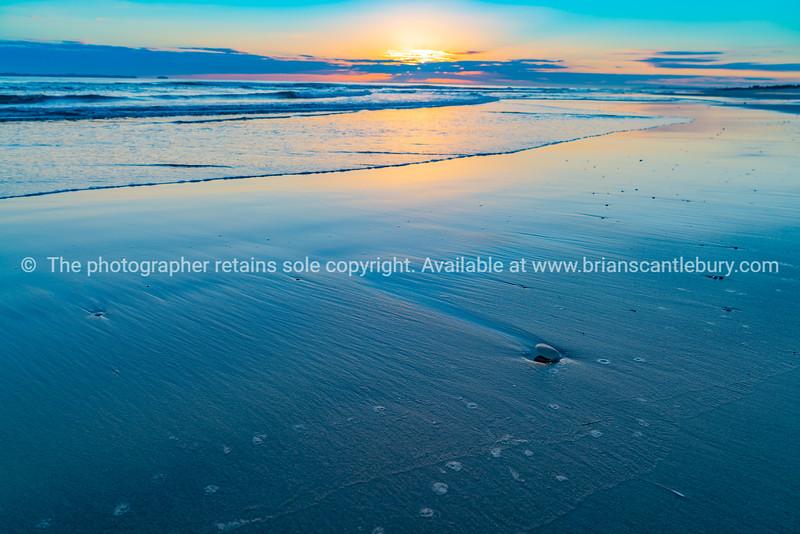 Oceanbeach as sun is on horizon