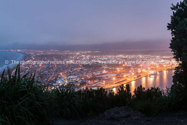 Mount Maunganui township lit by night lights from top of Mount Maunganui. Tauranga, Mount Maunganui photos
