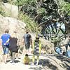 People walking the Mount Maunganui base track