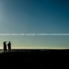 """Silhouetted form of a couple at sunrise looking along Mount Maunganui ocean beach. See;  <a href=""""http://www.blurb.com/b/3811392-tauranga"""">http://www.blurb.com/b/3811392-tauranga</a> mount maunganui landscape photography, Tauranga Photos; Tauranga photos, Photos of Tauranga Also see; <a href=""""http://www.brianscantlebury.com/Events"""">http://www.brianscantlebury.com/Events</a>"""