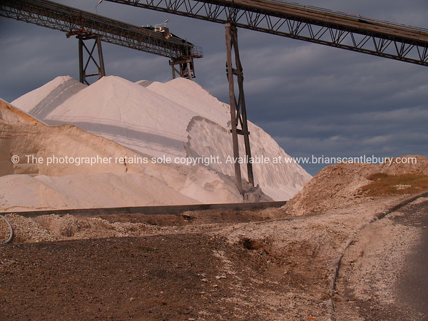 """White salt hills and conveyor belt. Tauranga scenics.<br /> <br /> Hill of white salt, and conveyors. Tauranga is New Zealands 5th largest city and offers a wonderfull variety of scenic and cultural experiences. Tauranga stock images Tauranga scenics. See;  <a href=""""http://www.blurb.com/b/3811392-tauranga"""">http://www.blurb.com/b/3811392-tauranga</a> mount maunganui landscape photography, Tauranga Photos; Tauranga photos, Photos of Tauranga Also see; <a href=""""http://www.brianscantlebury.com/Events"""">http://www.brianscantlebury.com/Events</a>"""