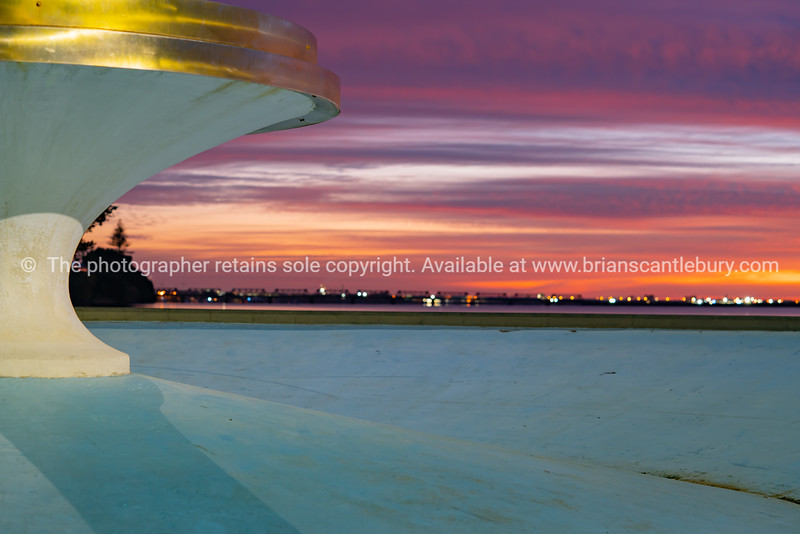 Empty fountain at Memorial park on vibrant sky at sunrise