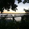 Tauranga's historic Railway Bridge framed by leafy trees at end Elizabeth Street.