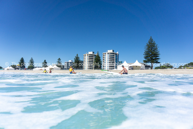 Mount Maunganui Main Beach and Marine Parade Buildings from the water.