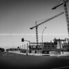Two tall cranes on Farmers construction site.
