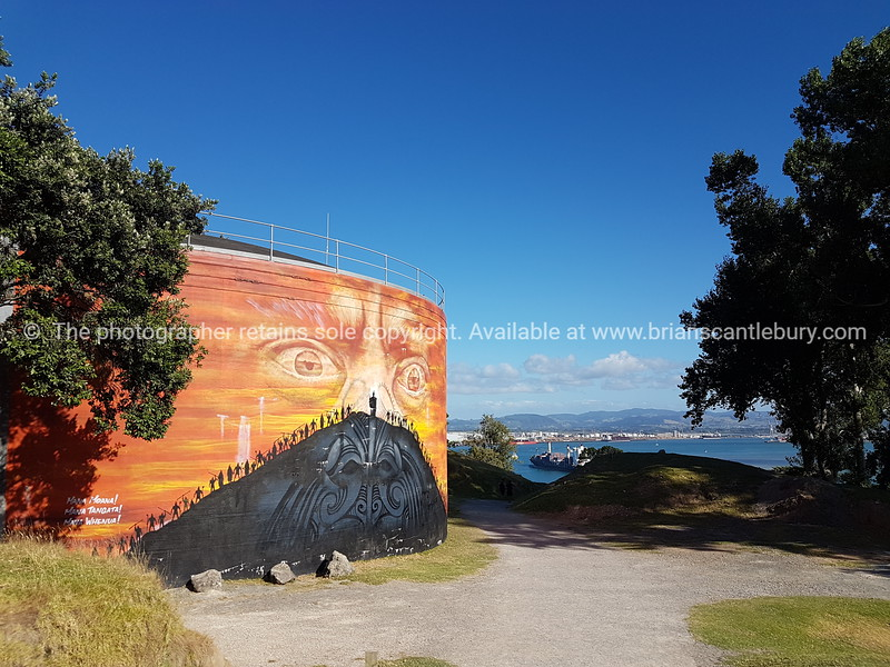 Water tank art,  the work of famous street artist known as Mr G on side of Mount Maunganui taken in February 2019