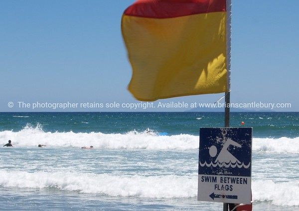 """Surf Lifesaving flag at Papamoa. Tauranga scenics.<br /> <br /> Lifesaver Flag. Tauranga is New Zealands 5th largest city and offers a wonderfull variety of scenic and cultural experiences. Tauranga stock images Tauranga scenics. See;  <a href=""""http://www.blurb.com/b/3811392-tauranga"""">http://www.blurb.com/b/3811392-tauranga</a> mount maunganui landscape photography, Tauranga Photos; Tauranga photos, Photos of Tauranga Also see; <a href=""""http://www.brianscantlebury.com/Events"""">http://www.brianscantlebury.com/Events</a>"""