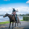 Tauranga New Zealand - August 22 2020; Horseman in Indian costume on road by city waterfront<br /> Editorial; for editorial or personal use only please.