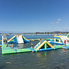 Young people having fun playing on inflatable waterworld