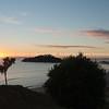 Rising sun on horizon from Mount Maunganui