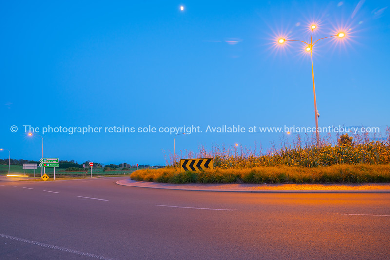 Intersection and roundabout at Papamoa Tauranga in morning light.