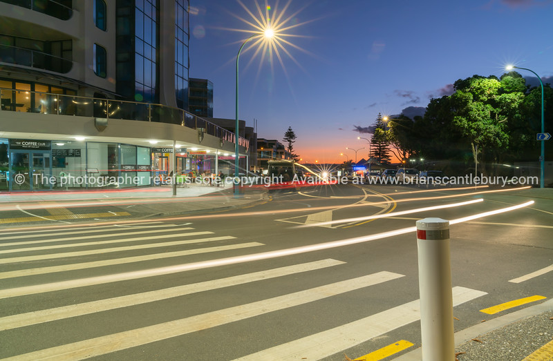 Mount Maunganui street scene and intense sunset sky.