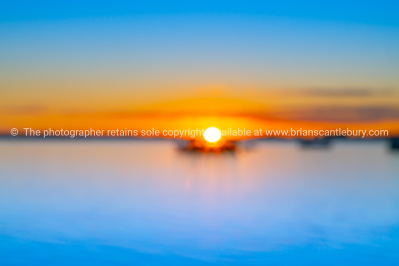 Blurred effect at sunrise over blue water of Tauranga harbour