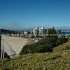 """Mount Maunganui township and ocean beach, the high rise buildings at the base of the Mount. Viewed from the slopes of iconic mountain. Tauranga is New Zealands 5th largest city and offers a wonderfull variety of scenic and cultural experiences. Tauranga stock images Tauranga scenics. See;  <a href=""""http://www.blurb.com/b/3811392-tauranga"""">http://www.blurb.com/b/3811392-tauranga</a> mount maunganui landscape photography, Tauranga Photos; Tauranga photos, Photos of Tauranga Also see; <a href=""""http://www.brianscantlebury.com/Events"""">http://www.brianscantlebury.com/Events</a>"""