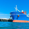 Bright blue and red cargo ship in port