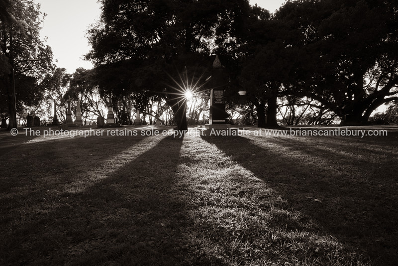 Durham Redoubt Tauranga at sunrise with sunburst and long shadows.