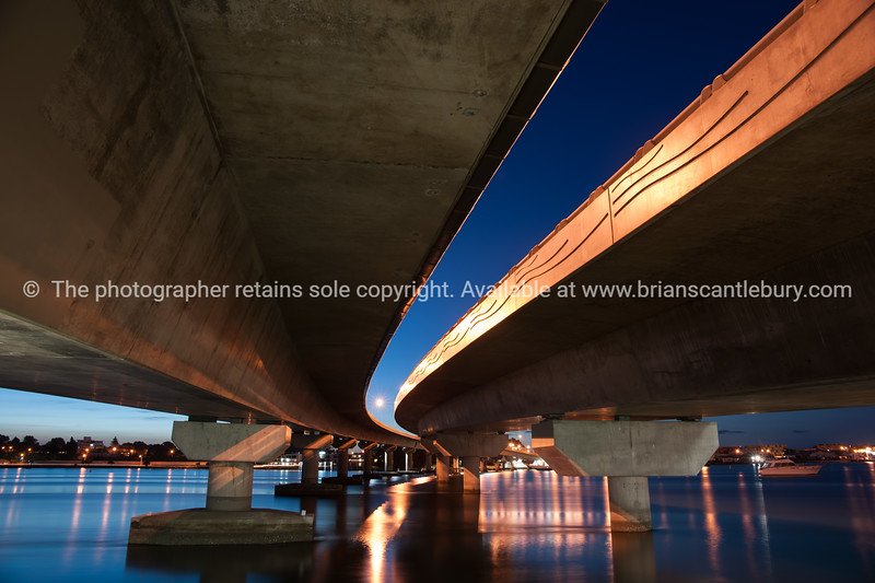 """Harbour brdge dual structures in diminishing perspective from below in the night light. at night See;  <a href=""""http://www.blurb.com/b/3811392-tauranga"""">http://www.blurb.com/b/3811392-tauranga</a> mount maunganui landscape photography, Tauranga Photos; Tauranga photos, Photos of Tauranga Also see; <a href=""""http://www.brianscantlebury.com/Events"""">http://www.brianscantlebury.com/Events</a>"""